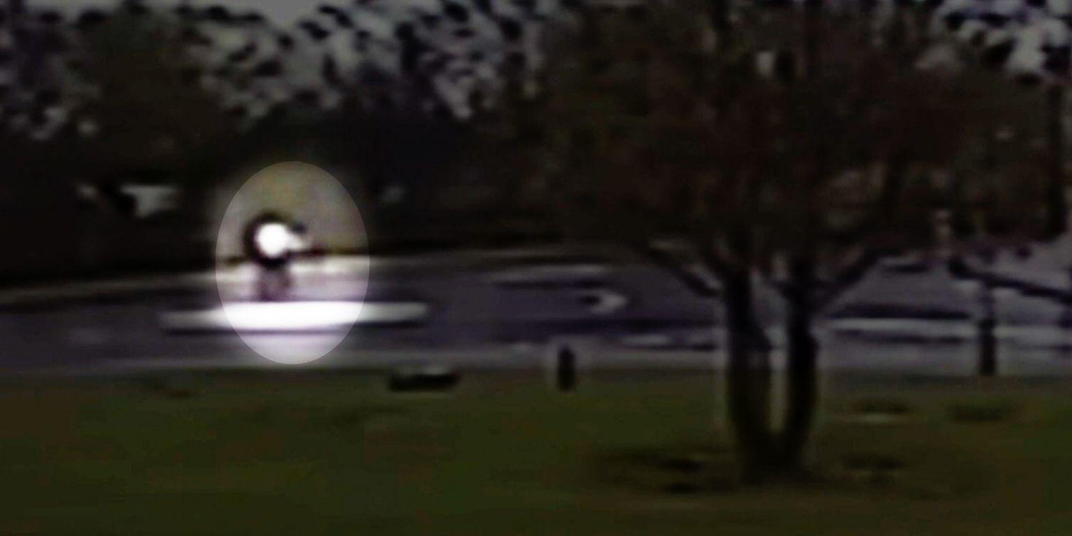 CCTV image of Sheku Bayoh walking erratically across a mini roundabout