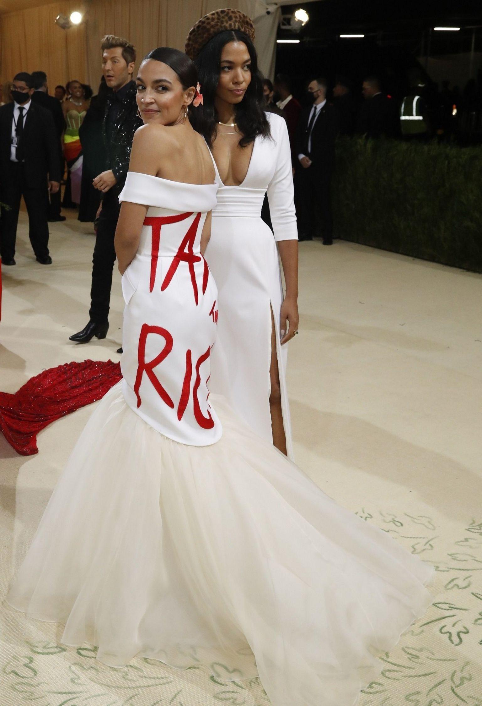 "Democratic congresswoman Alexandria Ocasio-Cortez in a dress emblazoned with the words ""Tax the Rich"""