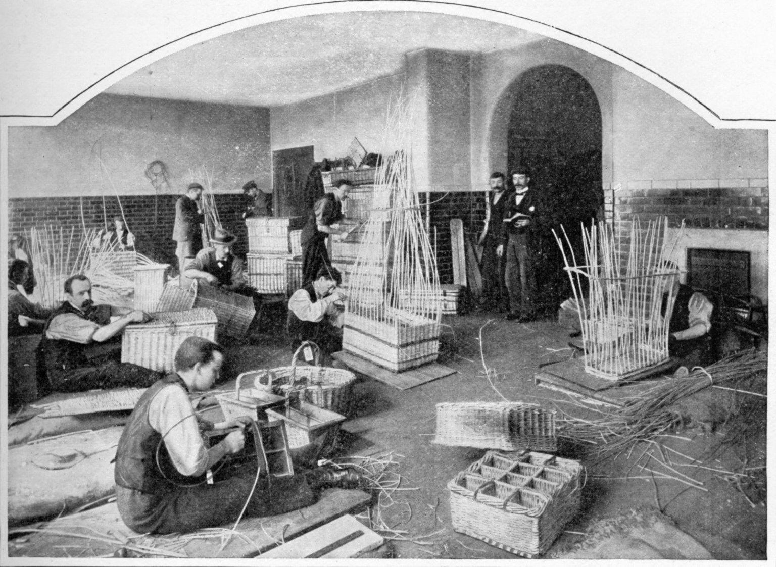 Black and white photo of blind men making baskets