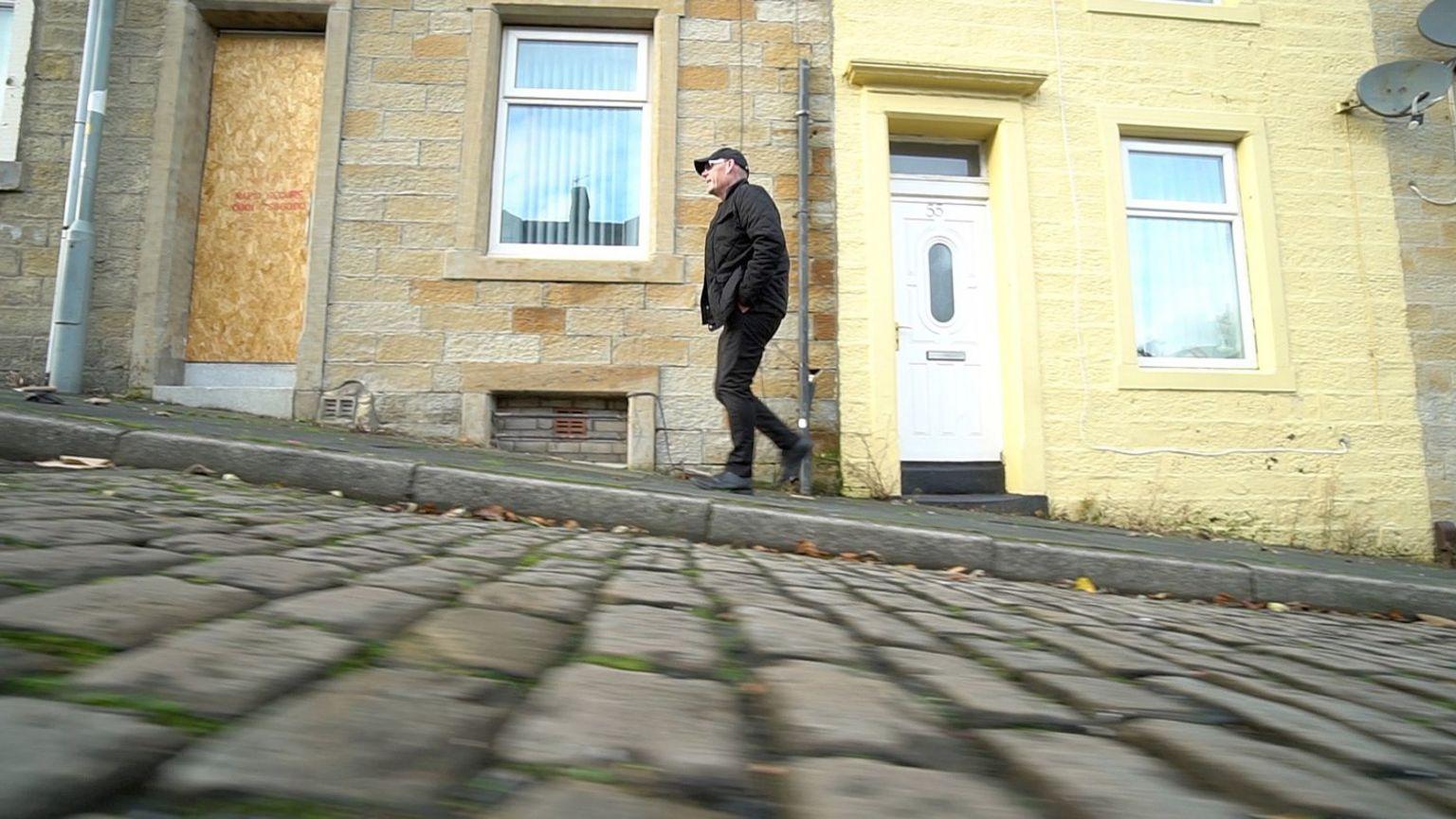 Pastor Mick Fleming on a Burnley street