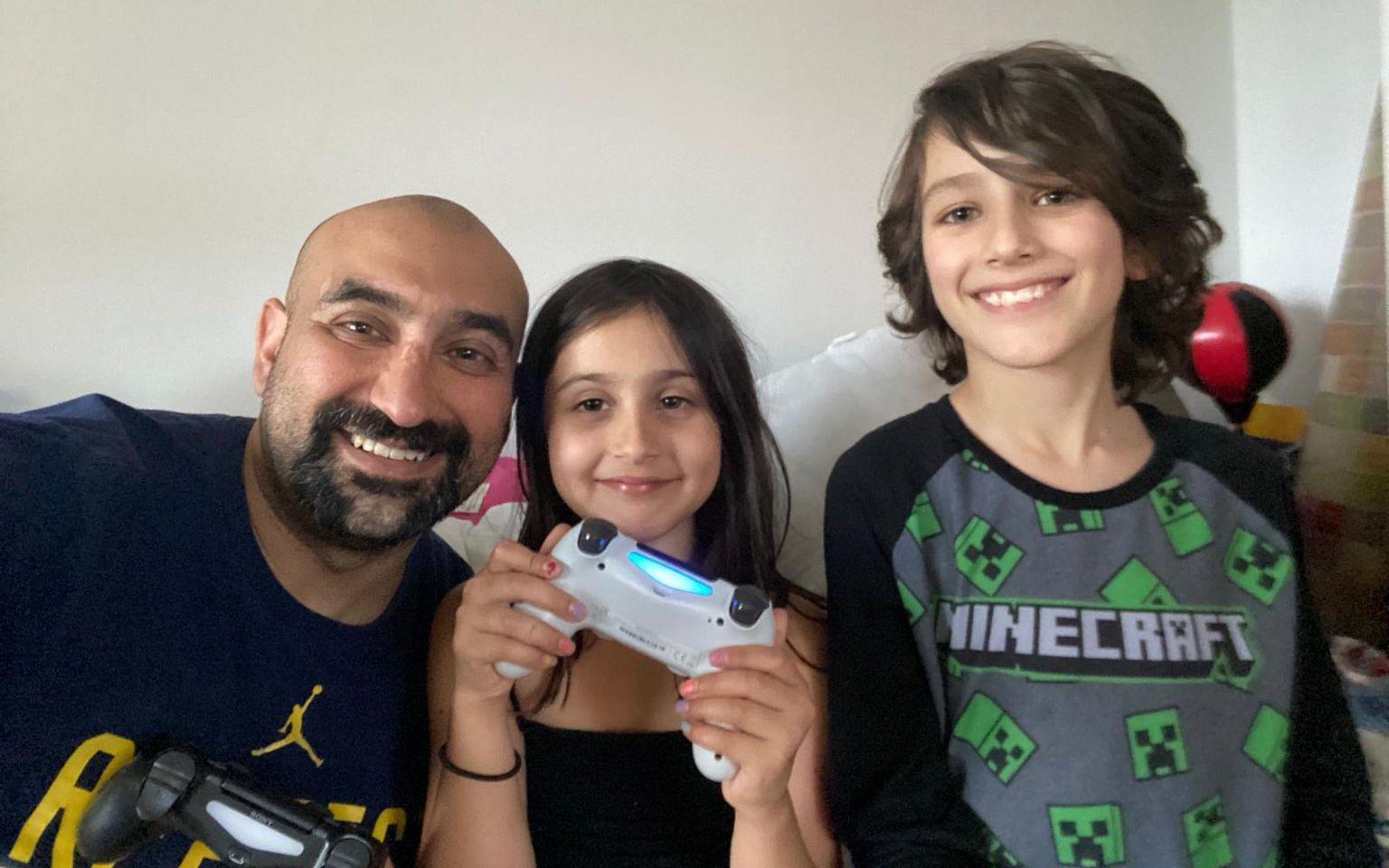 Sam Khan with his children