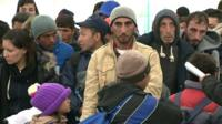 People arriving on the border between Slovenia and Croatia
