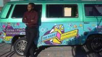 Counsellor Andreas Banetsi Mphunga in front of his van in Cape Town, South Africa