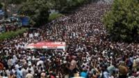 Thousands of people attend the funeral procession of Amjad Sabri, killed when unidentified gunmen open fire on his car in Karachi, Pakistan