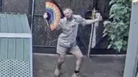 Dancing zookeeper waves a fan around during a livestream at Melbourne Zoo