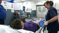 Nurse with patient on gurney in Belfast hospital