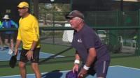 Men playing racquet ball