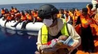 A baby rescued by Italian coastguard