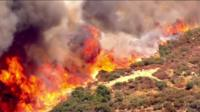 A brush fire in Devore, California.
