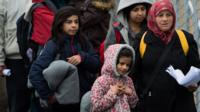 Refugees and migrants near the village of Spielfeld, Austria, 16 February 2016.