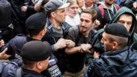 Police confront opposition activists in Moscow