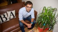 BlaBlaCar co-founder sitting on a sofa in the company's London office
