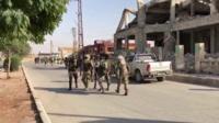 Forces walk through Tel Abyad
