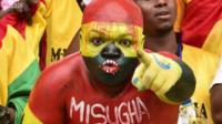 Fan covered in body paint