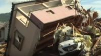 House swept on top of car, Japan