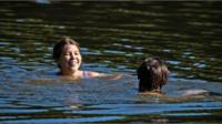 Swimmer in Hampstead pond, London