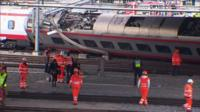 Train passengers are rescued after a derailment in Lucerne, Switzerland