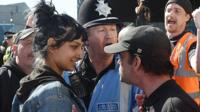 Saffiyah Khan smiling at an EDL protester