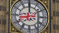 A British Union flag in front of Big Ben.
