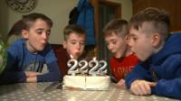 Four children blow out birthday candles