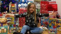 Lily with presents she has collected for hospital patients