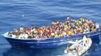 A boat crowded with refugees off the Italian coast in the Strait of Sicily, 22 August