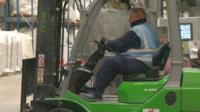 Night worker driving forklift truck