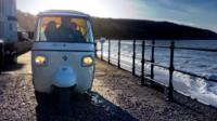 Scout driving his tuk-tuk on the Isle of Wight