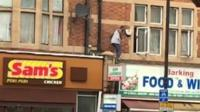A man on a roof in Barking.