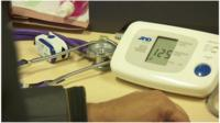 Doctor's desk, stethoscope; arm; blood pressure machine