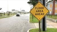 Flood area ahead sign