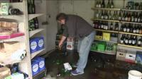 Business owner cleans up quake damage