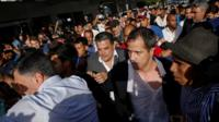 Juan Guaido amid a crowd at the airport