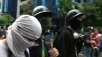 'Resistance' members in balaclavas and gasmasks