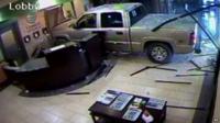 Vehicle crashes into hotel lobby