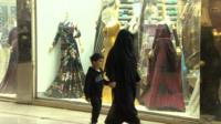 Saudi woman and child in a shopping mall