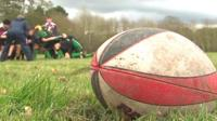 Rugby ball and children playing rugby