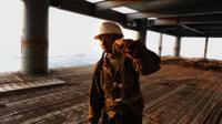 A Chinese worker makes his way along a construction project