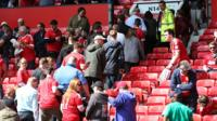 Fans leaving Old Trafford