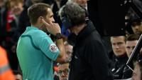 A referee consults with a video assistant referee