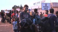 Refugees queue at Serbia-Hungary border