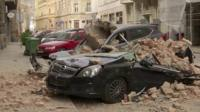 Car crushed by debris