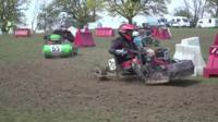 Two drivers in the first race of the Lawnmower racing season.