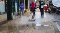 Cleaning a street in Bradford