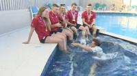 BBC Sport presenter Mike Bushell falls into the pool