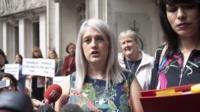 Sarah Ewart (centre) speaks outside Supreme Court London
