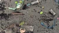 The beach strewn with medical waste