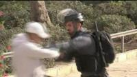 Israeli soldier clashes with young Palestinian man