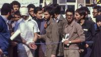 One American hostage and a group of Iranian students