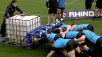 Osprey rugby players practising a scrum